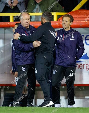 Stock Picture of Rangers Caretaker Manager Jimmy Nicholl embraces Aberdeen Manager Derek McInnes after the final whistle, with Rangers Caretaker Assistant Manager Jonatan Johansson (right).