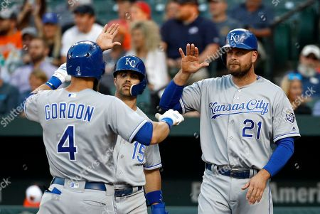 Stock Photo of Whit Merrifield, Lucas Duda, Alex Gordon. Kansas City Royals' Whit Merrifield (15) and Lucas Duda (21) greet teammate Alex Gordon after Gordon drove them in with a three-run home run during the first inning of a baseball game against the Baltimore Orioles, in Baltimore
