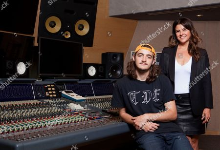 Deacon Frey, son of the late Eagles co-founder Glenn Frey, left, and his mother Cindy Frey pose for a portrait at Dog House Recording Studio in Los Angeles. Deacon Frey is keeping his dad's legacy alive by touring and performing with the Eagles. Cindy Frey, is the executor of her husband's estate