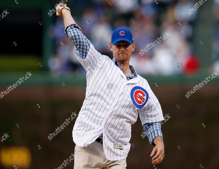 Stock Photo of Former Chicago Cubs pitcher Kerry Wood throws out the ceremonial first pitch before a baseball game between the Cubs and the Miami Marlins, in Chicago