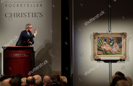 """Global president of Christie's Jussi Pylkkanen taps the gavel on the podium for the final sale of Henri Matisse's """"Odalisque couchee aux magnolias"""" for $71.5 million during an auction from the collection of Peggy and David Rockefeller, in New York"""