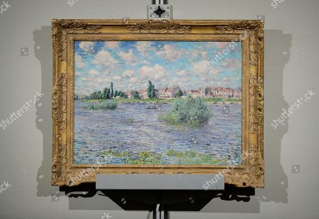 """Claude Monet's """"La Seine a Lavacourt"""" hangs on display during an auction at Christies from the collection of Peggy and David Rockefeller, in New York"""