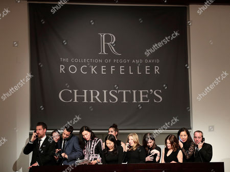 Bidding representatives take bids from buyers during an auction from the collection of Peggy and David Rockefeller, at Christies in New York