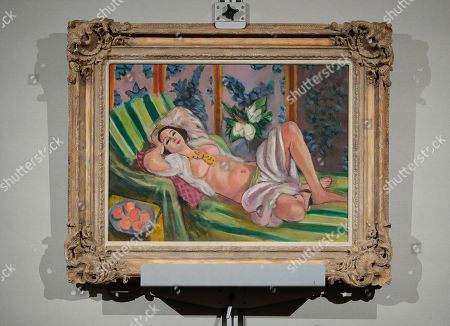 """Henri Matisse's """"Odalisque couchee aux magnolias"""" hangs on display during an auction from the collection of Peggy and David Rockefeller, at Christies in New York. The painting sold for for $71.5 million"""