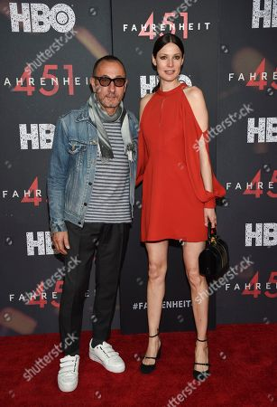 """Designer Gilles Mendel and guest attend the premiere of HBO Films' """"Fahrenheit 451"""" at the NYU Skirball Center, in New York"""