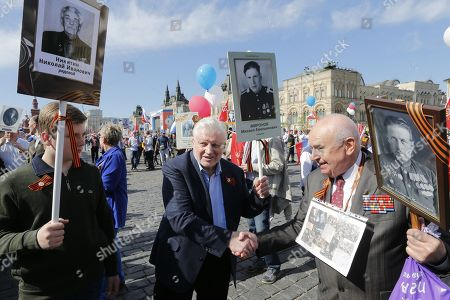 Sergei Mironov (C), leader of the Just Russia party and Russian people carry portraits of their relatives, participants of World War II during an Immortal Regiment memorial demonstration in Moscow, Russia, 09 May 2018. Russia marks the 73rd anniversary of the victory over Nazi Germany in World War II.