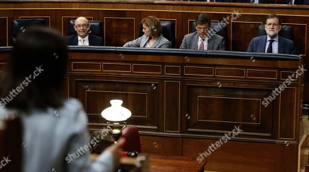 Spanish Prime Minister, Mariano Rajoy (R), looks on next to the Minister of Treasury, Cristobal Montoro; the Minister of Defense, Maria Dolores de Cospedal (2L), and Minister of Justice, Rafael Catala, during the Government's Question Time at the Lower House in the Spanish Parliament, in Madrid, Spain, 09 May 2018.