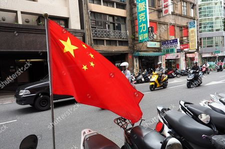 China's national flag flies outside the office of a pro-China organization in Taipei, Taiwan, 09 May 2018. On 09 May, former president Ma Ying-jeou said that Taiwan's seeking independence is unnecessary and impossible. The challenge facing China and Taiwan is to get the two sides achieve peaceful reunification. Ma said that the German formula can be the best referemce because the two Germanies were reunified in 1990 on the basis of long-time reconcilliation.