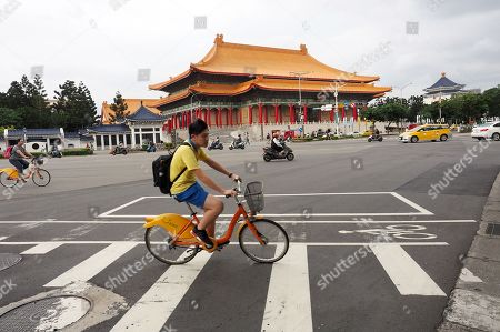 A boy riding a bicycle passes the National Theater in Taipei, Taiwan, 09 May 2018. On 09 May, former president Ma Ying-jeou said that Taiwan's seeking independence is unnecessary and impossible. The challenge facing China and Taiwan is to get the two sides achieve peaceful reunification. Ma said that the German formula can be the best referemce because the two Germanies were reunified in 1990 on the basis of long-time reconcilliation.