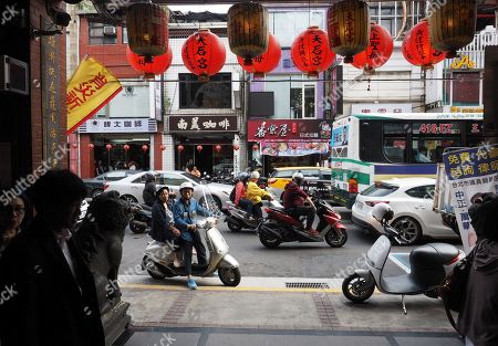 Traffic on the road seen from the hallway of a Taoist temple in Taipei, Taiwan, 09 May 2018. On 09 May, former president Ma Ying-jeou said that Taiwan's seeking independence is unnecessary and impossible. The challenge facing China and Taiwan is to get the two sides achieve peaceful reunification. Ma said that the German formula can be the best referemce because the two Germanies were reunified in 1990 on the basis of long-time reconcilliation.