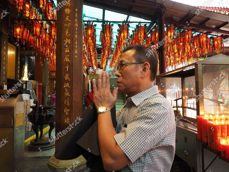 A man prays in a Taoist temple in Taipei, Taiwan, 09 May 2018.  On 09 May, former president Ma Ying-jeou said that Taiwan's seeking independence is unnecessary and impossible. The challenge facing China and Taiwan is to get the two sides achieve peaceful reunification. Ma said that the German formula can be the best referemce because the two Germanies were reunified in 1990 on the basis of long-time reconcilliation.