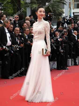 Actress Wang Likun poses for photographers upon arrival at the premiere of the film 'Yomeddine' at the 71st international film festival, Cannes, southern France