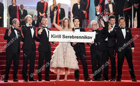 Francois Erlenbach, Ilya Stewart, Irina Starshenbaum, Teo Yoo, Charles-Evrard Tchekhoff and Thierry Fremaux hold a banner with Director Kirill Serebrennikov's name