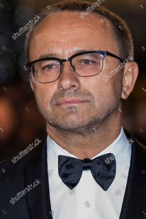 Jury member Andrey Zvyagintsev poses for photographers upon arrival at the premiere of the film 'Leto' at the 71st international film festival, Cannes, southern France