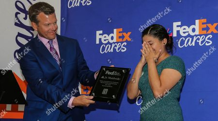 Rosa Santos from JA of North Florida reacts as Todd Lewis of the Golf Channel announces she will advance to the FedEx Junior Business Challenge finals. Students presented original business concepts to panel judges Billy Horschel (2014 FedExCup champion), Denny Hamlin (2016 Daytona 500 winner), Shannon Miller (7x Olympic medal gymnast) and Mary Lynn Schroeder (In Blue Handmade founder and FedEx Small Business Grant winner at THE PLAYERS Championship. Santos will join JA students from three other qualifying events held at PGA TOUR tournaments this season at the TOUR Championship for the chance to generate a $75,000 donation from FedEx to their local JA chapter., in Ponte Vedra Beach, Fla
