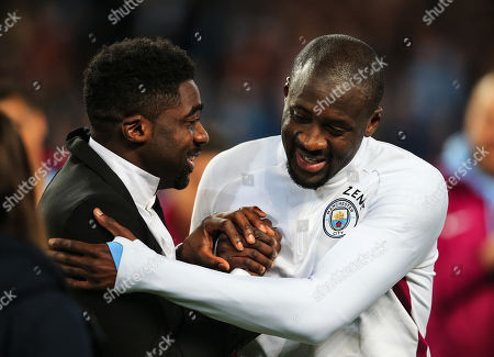 Yaya Toure is greeted by his brother Kolo Toure after the match