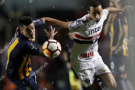 Nene of Brazil's Sao Paulo, right, fights for the ball with Mauricio Martinez of Argentina's Rosario Central, during a Copa Sudamericana soccer match in Sao Paulo, Brazil