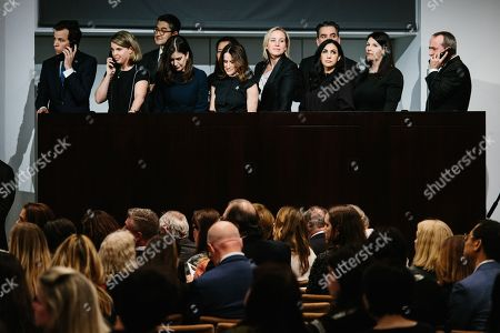 Sales people attend to phonecalls during the sales event of The Collection of Peggy and David Rockefeller at Christie's auction house in New York, New York, USA, 09 May 2018. The artwork is part of the 'Collection of Peggy and David Rockefeller: 19th and 20th Century Art Evening Sale' that will place in New York from 08 to 10 May 2018.