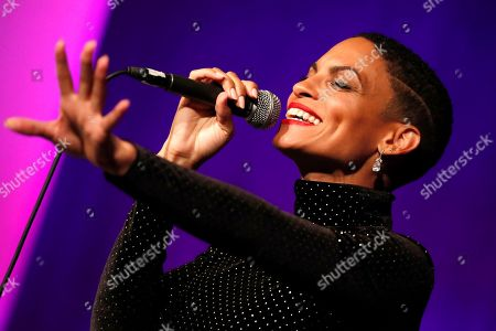 Stock Image of Goapele performs at Vote For Justice: An Evening of Empowerment with activists and artists at the Newseum, in Washington, D.C. The event was sponsored by The Justice Roundtable and served to reinvigorate the criminal justice reform movement