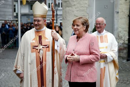 German Chancellor Angela Merkel is greeted by the Bishop of Aachen, Helmut Dieser, at her arrival for the Charlemagne Prize ceremony at the Cathedral in Aachen, Germany, 10 May 2018. Macron was named to receive the prestigious Charlemagne Prize on 10 May 2018. Annually since 1950, the 'Karlspreis' has been awarded to people who contributed to the unity of Europe and is given by the German city of Aachen.