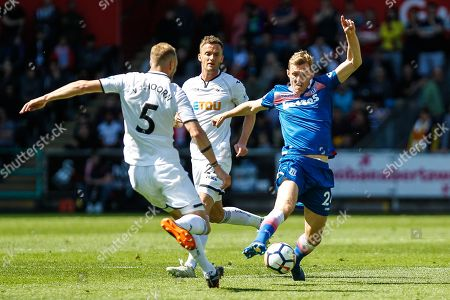 Mike van der Hoorn of Swansea City and Darren Fletcher of Stoke City