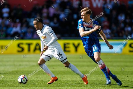 Martin Olsson of Swansea City and Darren Fletcher of Stoke City