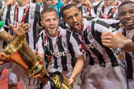 Miralem Pjanic of Juventus and Medhi Amine Benatia El Moutaqui of Juventus with Trophy