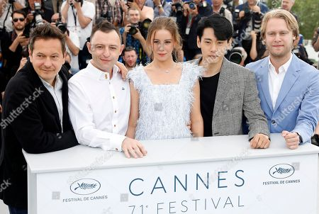 (R-L) Director of Photography Vladislav Opeliants, German actor Teo Yoo, Russian actress Irina Starshenbaum, Russian actor Roma Zver and Producer Ilya Stewart pose during the photocall for 'Leto' at the 71st annual Cannes Film Festival, in Cannes, France, 10 May 2018. The movie is presented in the Official Competition of the festival which runs from 08 to 19 May.