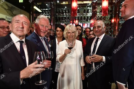Prince Charles (2nd L), Prince Charles and Camilla (C), Camilla Duchess of Cornwall, French Interior Minister Gerard Collomb (L) and Lyon's Mayor Georges Kepenekian visit the Halles de Lyon, in Lyon, central eastern France