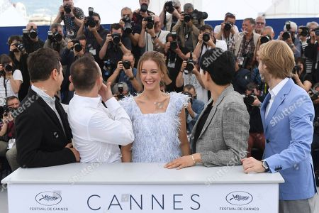 Vladislav Opelyants, Roma Zver, Irina Starshenbaum, Teo Yoo, Ilya Stewart. Director of photography Vladislav Opelyants, from left, actors Roma Zver, Irina Starshenbaum, Teo Yoo and producer Ilya Stewart pose for photographers during a photo call for the film 'Leto' at the 71st international film festival, Cannes, southern France