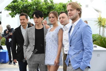 Vladislav Opelyants, Teo Yoo, Irina Starshenbaum, Roma Zver, Ilya Stewart. Director of photography Vladislav Opelyants, from left, actors Teo Yoo, Irina Starshenbaum, Roma Zver and producer Ilya Stewart pose for photographers during a photo call for the film 'Leto' at the 71st international film festival, Cannes, southern France