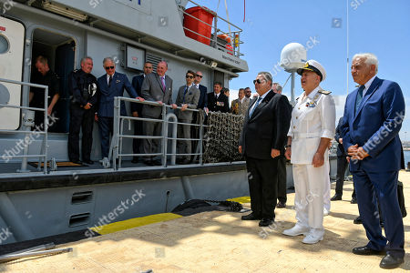 Prince Charles on board HMS Valiant with Minister of Defence Panos Kammenos (3rd R) in Piraeus