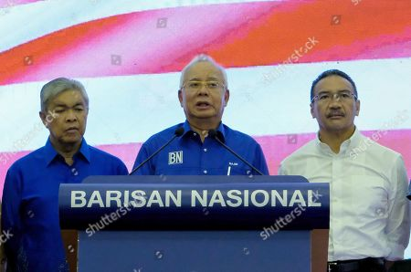 Malaysia Prime Minister ruling National Front coalition (Barisan Nasional) party President, Najib Tun Razak (C) speak to journalist during press conference at Putra World Trade Centre in Kuala Lumpur