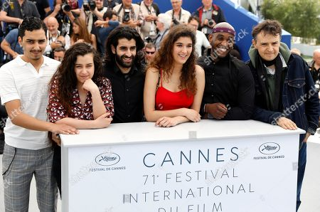 (R-L) French director Antoine Desrosiers, French actor Elis Gardiole, French actress Inas Chanti, French actor Mehdi Dahmane, French actress Souad Arsane and French actor Sidi Mejai pose during the photocall for 'Sextape (A Genoux Les Gars)' at the 71st annual Cannes Film Festival, in Cannes, France, 10 May 2018. The movie is presented in the section Un Certain Regard of the festival which runs from 08 to 19 May.