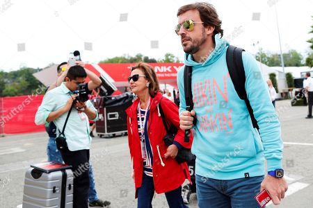 Spanish Formula One driver Fernando Alonso of McLaren, accompanied by his mother Ana Maria Diaz, walks in the paddock at the Circuit de Barcelona-Catalunya race track in Montmelo, Spain, 10 May 2018. The 2018 Formula One Grand Prix of Spain will take place on 13 May.