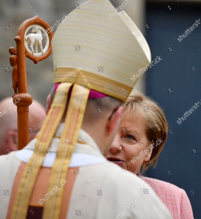 German Chancellor Angela Merkel talks to the Bishop of Aachen prior the Charlemagne Prize awarding in Aachen, Germany