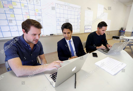 Suneel Gupta, center, works with campaign manager Michael Kurtz, left, and finance associate Michael Flores at his campaign headquarters in Livonia, Mich. Gupta is a Democrat in a crowded field to replace U.S. Rep. Dave Trott, R-Mich., in Michigan's 11th Congressional District. A record number of Asian-Pacific Americans are running for Congress, including some three dozen Democrats eager to help flip Republican seats in the House