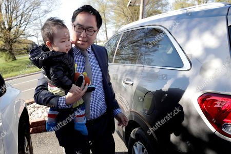 Andy Kim, August Kim. Andy Kim carries his 9-month-old son, August Kim, on his first day of school in Bordentown, N.J. Kim, who grew up in Marlton, N.J., is running for U.S. Congress