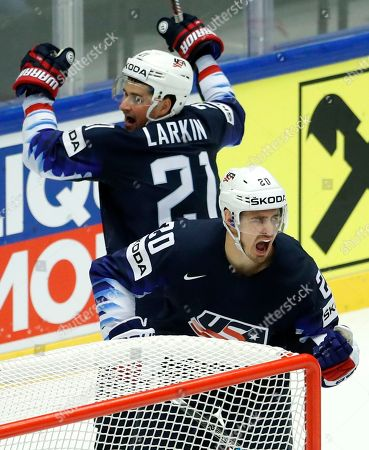 Chris Kreider, right, of the United States celebrates with teammate Dylan Larkin, left, after scoring his sides first goal during the Ice Hockey World Championships group B match between United States and Latvia at the Jyske Bank Boxen arena in Herning, Denmark