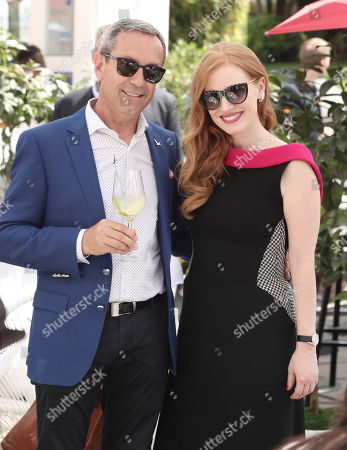 Stock Image of Grey Goose Cellar Master Francois Thibault and Jessica Chastain