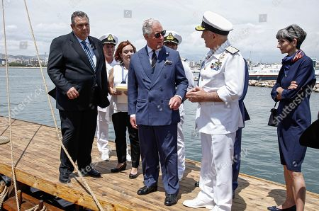 Prince Charles with Defence Minister Panos Kammenos (L) on trireme replica Olympias in Floisvos near Athens