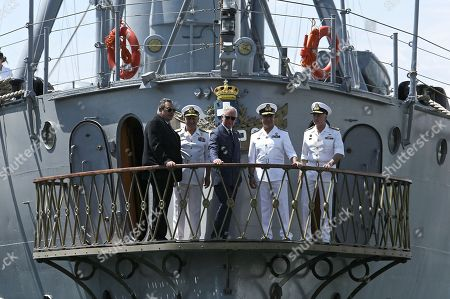 Prince Charles and Minister of Defence Panos Kammenos (L) on board Battle Ship G. Averof in Floisvos near Athens