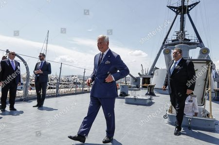Prince Charles on the top deck of Battle Ship G. Averof followed by Defence Minister Panos Kammenos in Floisvos near Athens