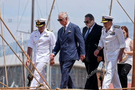 Prince Charles with Defence Minister Panos Kammenos (3rd L) on trireme replica Olympias in Floisvos near Athens