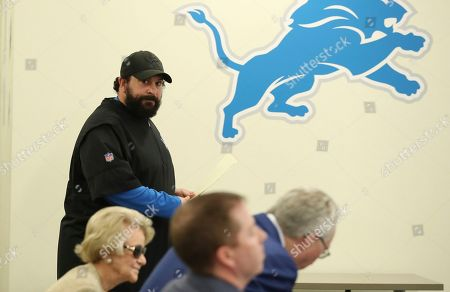 Detroit Lions head coach Matt Patricia looks towards team owner Martha Firestone Ford, left, general manager Bob Quinn, center, and president Rod Wood as he prepares to meet the media at the team's football training facility, in Allen Park, Mich. Patricia addressed the 1996 sexual assault allegation against him which surfaced in media reports