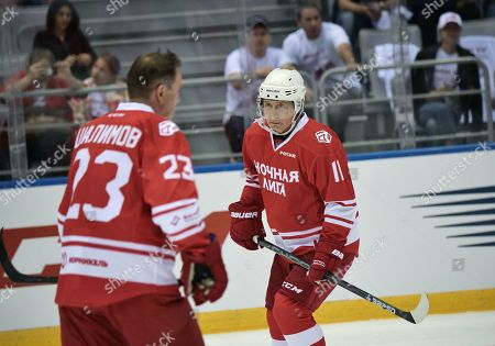 Stock Photo of Russian President Vladimir Putin (R)  takes part in a gala ice hockey match of the Night Hochey League, a tournament of amateur hockey teams in Sochi, Russia, 10 May 2018. In one team with Putin play Defense Minister Sergei Shoigy, Tula governor Alkexei Dyumin and former NHL stars Viacheslav Fetisov, Alexei Kasatonov, Alexander Mogilny and other.