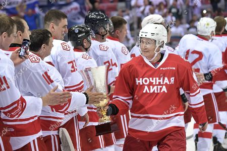 Russian President Vladimir Putin (R)  takes part in a gala ice hockey match of the Night Hochey League, a tournament of amateur hockey teams in Sochi, Russia, 10 May 2018. In one team with Putin play Defense Minister Sergei Shoigy, Tula governor Alkexei Dyumin and former NHL stars Viacheslav Fetisov, Alexei Kasatonov, Alexander Mogilny and other.