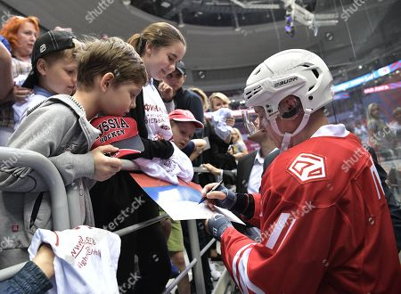 Stock Image of Russian President Vladimir Putin (R) signs autographs for children after taking part in a gala ice hockey match of the Night Hochey League, a tournament of amateur hockey teams in Sochi, Russia, 10 May 2018. In one team with Putin play Defense Minister Sergei Shoigy, Tula governor Alkexei Dyumin and former NHL stars Viacheslav Fetisov, Alexei Kasatonov, Alexander Mogilny and other.
