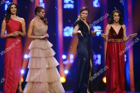 Stock Image of From left, presenters Daniela Ruah, Catarina Furtado, Silvia Alberto and Filomena Cautela on stage in Lisbon, Portugal, during the second semifinal of the Eurovision Song Contest. The Eurovision Song Contest grand final takes place in Lisbon on Saturday May 12, 2018