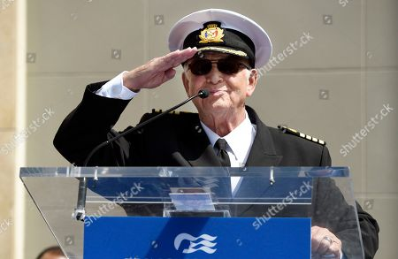 """Gavin MacLeod, a cast member on the TV series """"The Love Boat,"""" salutes the crowd as he speaks at a Friends of Hollywood Walk of Fame honorary star plaque ceremony for the cast and Princess Cruises, in Los Angeles"""